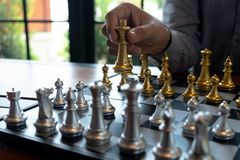 Close-up photos of checkmate hands on a chessboard during a chess game The concept of business victory strategy wins the intellige. Nce game stock photography