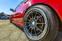 Close-up photos of red car with chrome wheel rims Stock Image