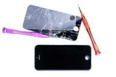 Photos showing the process of repairing a broken mobile phone with a screwdriver in the laboratory for repair of mobile equipment. Close-up photos showing the royalty free stock photo