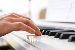 Close Up Of Pianists Hand Playing Piano  Shallow Deep Of Field