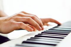 Close up of pianists hand playing piano. Shallow deep of field. Close up of pianists hands playing piano. Shallow deep of field Stock Photos