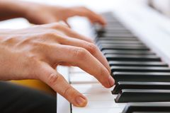 Close up of pianists hand playing piano. Shallow deep of field. Close up of pianists hands playing piano. Shallow deep of field Royalty Free Stock Image