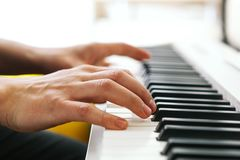 Close up of pianists hand playing piano. Shallow deep of field. Close up of pianists hands playing piano. Shallow deep of field Stock Image