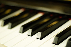 Close-up piano keys background with selective focus Royalty Free Stock Photos