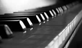 Close-up of piano keys. close frontal view. Closeup of antique piano keys and wood grain Royalty Free Stock Images