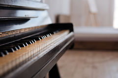 Close up of piano keys and dark wooden grain Stock Images