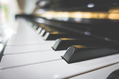 Close up of Piano keys with selective focus ,Filtered image proc Stock Photos