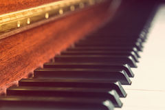 Close up of piano keys in vintage retro color style. Selective focus on a black key Royalty Free Stock Images