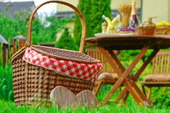 Close-up Of Picnic Basket With Checkered Cloth On The Lawn Stock Photos