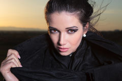 Close up picture of a beautiful woman pulling her scarf Royalty Free Stock Photography