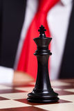 Close-up picture of a black chess king Stock Photos
