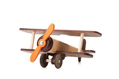 Close-up of an eco-friendly product for children`s games, isolated on a white background. A developing toy airplane. Stock Photo