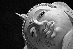 Close up picture of Buddha head. Picture in black and white tone. Religion and serenity concept stock image