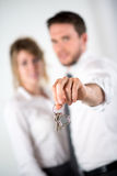 Close-up picture of cheerful young realtor couple holding house keys Stock Photography