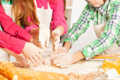 Close up picture of children's hands making dough Royalty Free Stock Image