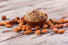 Close-up picture of chocolate cupcake with almonds Stock Image
