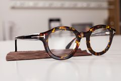 Corrective eye glasses. Close up picture of corrective eye glasses in an optics store stock images