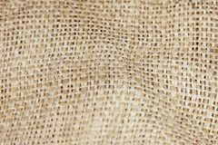 Close up picture of crumpled old burlap background. Ecological, natural fabric packing issue, rustic jute backdrop royalty free stock photo