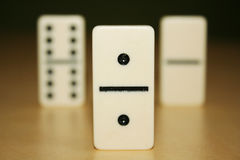 Close up picture of dominos, one from the crowd Royalty Free Stock Image