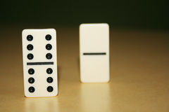 Close up picture of dominos, one from the crowd Royalty Free Stock Photos