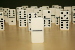 Close up picture of dominos, one from the crowd Royalty Free Stock Photography