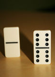 Close up picture of dominos, one from the crowd Royalty Free Stock Images