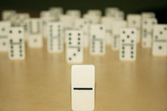 Close up picture of dominos, one from the crowd Stock Images