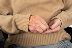 Elderly hands holding pills. Close up picture of elderly woman`s hands holding medical pills - illness, influenza, prescription, painkillers royalty free stock images