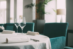 Close up picture of empty glasses in restaurant. Selective focus. Royalty Free Stock Photography