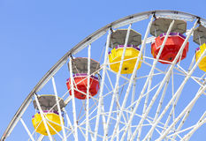 Close up picture of ferris wheel against blue sky. Stock Photography