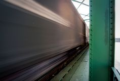 Close up picture of freight train in motion on bridge royalty free stock image