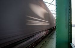Close up picture of freight train in motion on bridge stock images