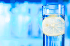 Close-up picture of glossy water glass with lemon Royalty Free Stock Photography