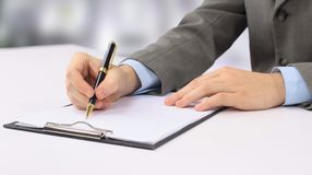 Close-up picture of hands writing Royalty Free Stock Photo