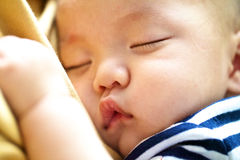 Close up picture of kid sleeping Stock Photos