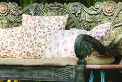 Close up picture of many pillows. On a wooden sofa with detail Stock Image