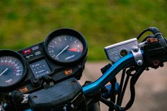 Close up picture of a motorcycles handlebars. Close up shot of motorcycle handlebars Stock Image