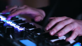 Close-up picture of music artists hands playing on electronic keyboard and  pressing pads on a control desk. stock video