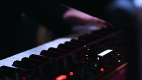 Close-up picture of music performers hands playing on electronic keyboard and turning knobs on a control desk. stock video footage