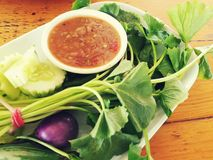 Close up picture of Nam Prik Kra Pi, Thai sauce dipping, and fresh vegetables. Royalty Free Stock Photography
