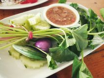 Close up picture of Nam Prik Kra Pi, Thai sauce dipping, and fresh vegetables. Stock Image