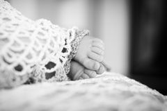 Close up picture of new born baby feet. Black-and-white photo. B Stock Photo