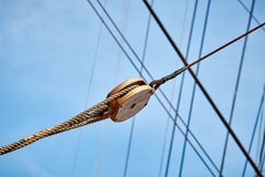 Close up picture of old sailing ship wooden pulley. Royalty Free Stock Images