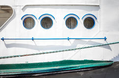 Close up picture of an old ship side and portholes Royalty Free Stock Photography