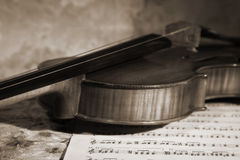 Close-up picture of the old violin witn score Stock Photos