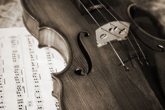 Close-up picture of the old violin witn score Stock Photography