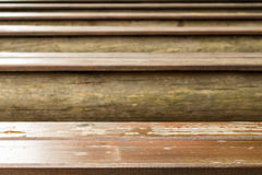 Close-up picture of an old wooden bench Royalty Free Stock Photos