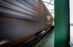 Close up picture of freight train in motion on bridge royalty free stock images