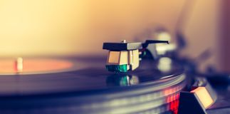 Playing retro music: Professional turn able audio vinyl record music player. Close up picture of a record player, playing a record vinyl music retro vintage stock photo