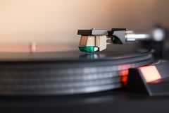 Playing retro music: Professional turn able audio vinyl record music player. Close up picture of a record player, playing a record vinyl music retro vintage stock photography